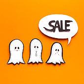 Happy ghosts predicting Halloween sales in speech bubble