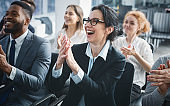 Perfect business lecture. Happy entrepreneurs applauding at conference