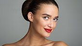 Beauty Model with Perfect Makeup and Red Lips