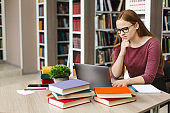 Serious student girl reading science article online