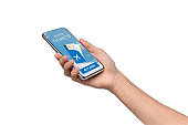 Smartphone with airline tickets app in male hand