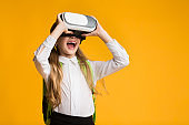 Excited Little Girl Experiencing Virtual Reality Using VR Headset