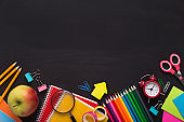 Blank space and Colored School stationery placed on chalk board