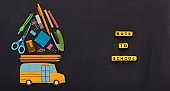 Yellow american bus with stationery on the top on chalk board