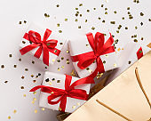 Gifts in wrapping paper with red bright ribbon