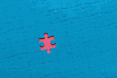 Pink hole in blue puzzle background, copy space