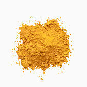 Heap of turmeric powder isolated on white background.