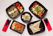 Healthy Food with fresh vegetables in black boxes to go