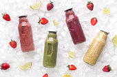 Healthy detox drink with fresh fruits and ice for sale on white
