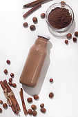 Brown healthy smoothie with cinnamon on white background