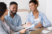 Gladful African American Couple Listening To Financial Counselor's Advice