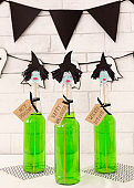 Halloween witches with green liquid bodies over bricks wall
