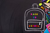 Chalk painted backpack with colored text on black background