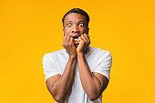 Scared African American Man Looking At Camera Standing, Studio Shot