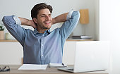 Business Man Relaxing Sitting At Laptop In Office