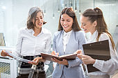 Business women with documents working together in office