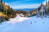 Ski slope in Bansko, Bulgaria and skiers