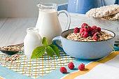 Useful homemade breakfast. Oatmeal, milk and fresh forest raspberries