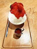 Bingsoo or Bingsu Korean dessert yummy frozen ice and famous with sweet strawberry sauce on top