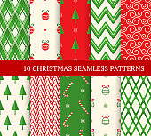 Ten Christmas different seamless patterns. Xmas endless texture for wallpaper, web page background, wrapping paper. Retro style. Waves, zigzags, curved lines, candies, Christmas balls and trees