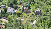 View from above to garden plots with cottages and greenhouses and garden beds