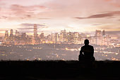 Lonely man looking at the city skyline