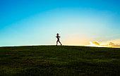 Female runner at sunset