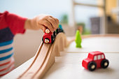 Cute little boy playing with toy train