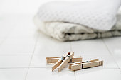 Laundry scissors and clean towels placed on the tiles
