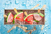 Top view of fresh watermelon ice cream on a stick