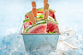 Cold ice cream made of watermelon on a stick