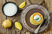 Cheese mashed potato cakes with sour cream and fresh dill