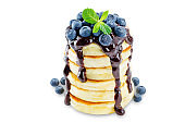 pancakes with sauce, berries and mint leaf