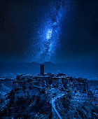 Milky way over old town of Bagnoregio, Italy
