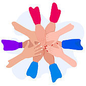 People putting their hands together. Friends with stack of hands. Unity and teamwork, top view