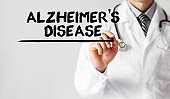 Doctor writing word Alzheimers Disease with marker, Medical concept