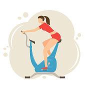 Woman Exercising on Stationary Bike