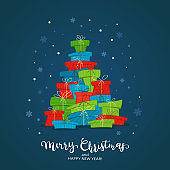 Lettering Merry Christmas on Blue Background with Holiday Gift Boxes