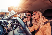 Portrait of scared couple in car
