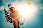Tennis player focused in ready position