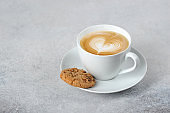 Cup with cappuccino coffee. Free space for text.