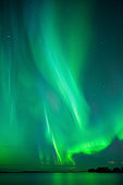 Aurora Borealis and stars above lake