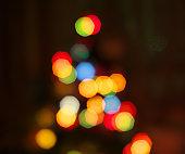 Blurred christmas tree lights isolated on black.