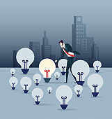 Businessman look the only bright light bulb - Business concept vector