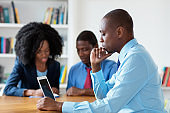 Working african american financial advisor with business team