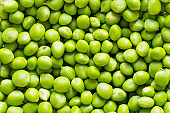 Peeled green pea background. Heap of fresh beans ready to eat.