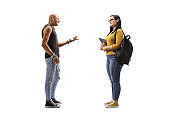 Male hipster talking to a female student holding books