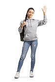 Female student waving