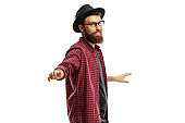 Hipster moving with arms