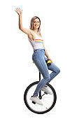 Young beautiful woman riding a unicycle and waving